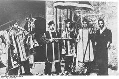 Spain - 1936. - GC - Milicianos vestidos con ropas litúrgicas tras el saqueo de una iglesia. Madrid.