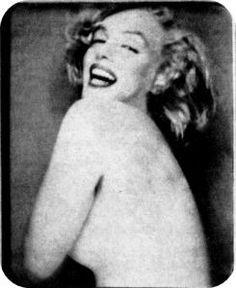 Marilyn Monroe posing in a photobooth for Richard Avedon