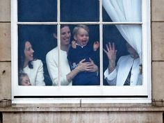 June 13, 2015 - Prince George looks through a window in Buckingham Palace prior to the Trooping The Color ceremony in London.