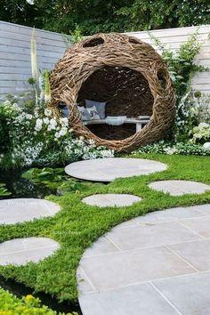 woven willow bird hide (willow sculpture) and concrete circular slabs as a path . pergola path woven willow bird hide (willow sculpture) and concrete circular slabs as a path .
