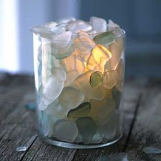 DIY project: Decorate a candle holder with sea glass. Choose two glass vases or tumblers of the same height but different diameters. Place the smaller one inside the larger one; add a votive. Fill the space between the containers with clear or colored sea glass.