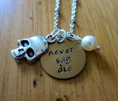 The Goonies movie Inspired Necklace. Never Say Die. Pirate, treasure. Hand stamped bronze colored with a Swarovski pearl & skull.
