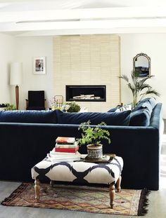 Rachel  Bilson living room - I have that ottoman, like the idea of using it as a side table