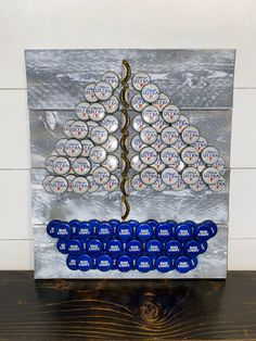 Excited to share this item from my shop: Handmade Rustic Bottle Cap Sailboat Wall Art, Farmhouse Decor, Nautical Decor Beer Cap Table, Bottle Cap Table, Beer Bottle Caps, Beer Caps, Diy Bottle Cap Crafts, Beer Cap Crafts, Bottle Cap Projects, Bottle Top Art, Blue Bottle