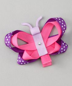 Uniquely designed and charmingly imaginative, this clip makes the perfect piece for jazzing up favorite outfits. Set atop a non-pinching alligator clip, it adds a major pop of personality to any little lovely's locks.Grosgrain ribbonImported