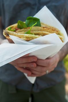 crepes street food photo by jackie alpers,  This vegetarian crepe had spinach, pesto, blue cheese, mushrooms and tomatoes.