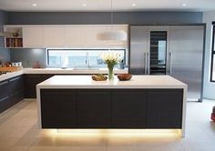 I'm not sure about the lightening but like the colour combinations in the kitchen for looking modern, but warmer than everything being white.