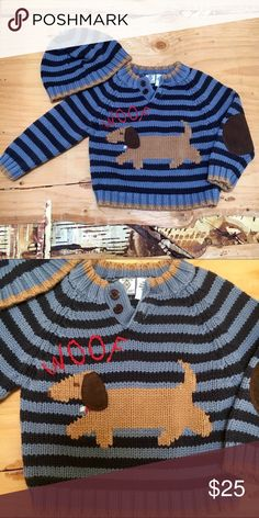 "Baby boy wiener dog striped sweater and beanie hat Knitted stripes in navy and heather blue make up this adorable sweater.  Weiner dog on front saying ""woof"".  Dark brown suede elbow patches a perfect added touch!  Button neck closure.  Brown trim at neck and bottom.  Matching beanie in same stripe with trim.  EUC!!  Colors are more accurate in 2nd pic. Bowen & Wright Shirts & Tops Sweaters"