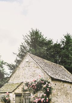 The tiny cottage stood, cozy and fair With flowering vines all rosy with care In the Cotswolds, tucked in among its kin This humble abode welcomes you in