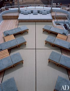On Giorgio Armani's yacht, Mariù, raffia mats cover the roof deck, which is furnished with wood chaise longues and side tables.