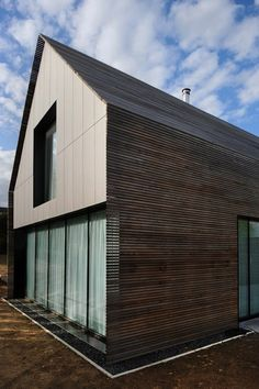Wood slat siding over glass and rain screen