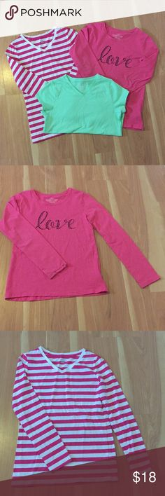 Girls shirts 2 long sleeve shirts and 1 short sleeve shirt. The all pink one is a size L(10/12) from Faded Glory. It has LOVE written on the chest in black sequence. The pink and white striped shirt is a size L(10/12) from Cherokee. The short sleeve shirt is a pastel light green. It is NWOT. It is a size L(10/12) from Faded Glory. Shirts & Tops Tees - Long Sleeve