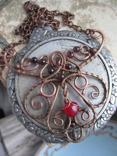 Ornate Filigree Wire Necklace - Whimsical Victorian Copper Wire - Swirl Spiral - Artisan Necklace Pendant - Victorian Neckklace - garnet red. $60.00, via Etsy.