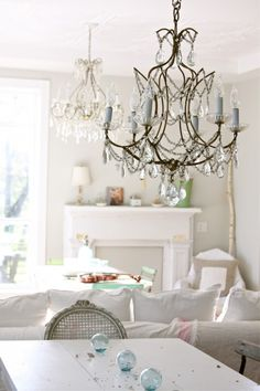 Shabby chic white living room dining area, chandelier, whitewashed, fireplace, mantel, vintage, French