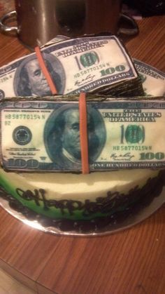 Chocolate cake on the bottom with white cake as the money stacks. All of this is done in buttercream with edible images for the face of the 100 dollar bill. The rubberbands are made of marshmello fondant.