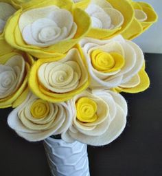 I love these felt flowers, they're so cute! I wan to figure out how to make these lovelies