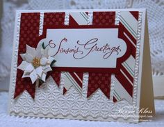 Poinsettia Christmas Card by Stamping with Klass.  Embossing Folder design base layered with banner snippets topped with a die cut stamped greeting and Spellbinders poinsettia die.