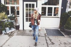 Leather jacket, hoodie, T-Shirt, distressed jeans, booties and beanie // Happily Grey