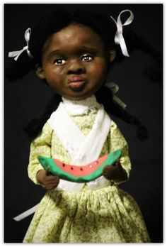 Ooak folk art black polymer clay art doll...nice vintage doll, but the watermelon in her hands was definitely a sign of the times.