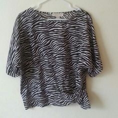 NEW Michael Kors zebra striped top Adorable new Michael Kors short sleeve zebra striped top. The top has an adorable side tie as well. Colors are white and brown Michael Kors Tops Tees - Short Sleeve