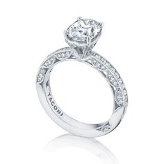 For the Tacori Girl who yearns for a classic look with an unconventional twist, this ring is pure perfection. An oval center diamond is illuminated with a completely open gallery, from which you can view it from every angle. Handcrafted according to your preference for either a soft point four-prong look or a spotlight diamond look, this ring is