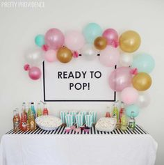 Ready to Pop Baby Shower ideas - popcorn topping bar, soda pop and balloons plus a free printable poster!