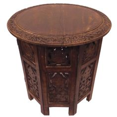 Give your home an antique appeal and create a beautiful display with the Celebration folding accent table. This handcrafted carved wood folding accent table includes four folding panels and one round top.