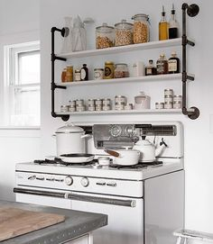 Vintage country kitchen stove and open shelves in this house tour of Sarah Gray Miller eclecticallyvintage.com: