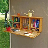 This outdoor storage would be cool to have hanging on the outside of a shed.