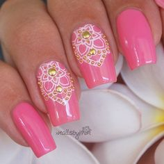 Super pretty lotus manicure with gold embellishments. Lotus nails. Pink nails, stamped nails. Gold nail studs