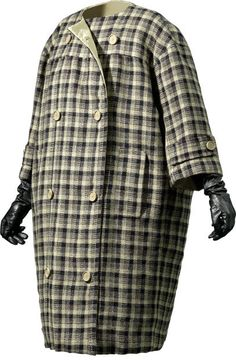 DÍA  Manteau réversible en sergé de laine beige et noire. Revers en taffetas de coton imperméabilisé  1957