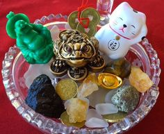 Symbols of wealth are different in different cultures. Feng shui (pronounced fung shway) is the popular Chinese art of placement. Using Chinese symbols, however, is not always best for non-Chinese people. Create your wealth bowl according to your own tradition.