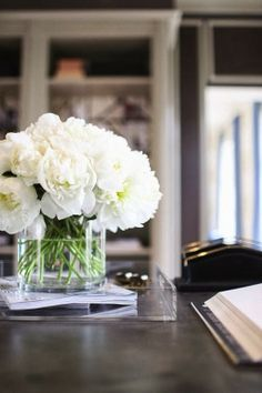 absolutely love the simplicity of this arrangement. this on a side table would bring a soft elegance to a room.