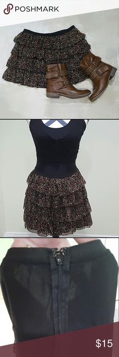 Floral Layered Skirt Floral layered skirt with elastic waist band. Has a zipper in the back with a hook at the top of the zipper. Perfect Condition! Forever 21 Skirts Circle & Skater