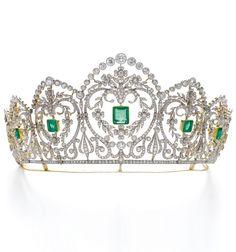 An Edwardian emerald and diamond tiara, circa 1910. Of floral, foliate and garland design, millegrain-set with step-cut emeralds, circular-, single-cut and cushion-shaped diamonds. #Edwardian #tiara