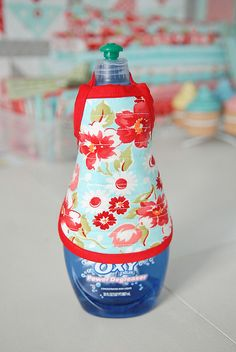 Hahaha, cute! Apron for a bottle of dish soap. Love it!