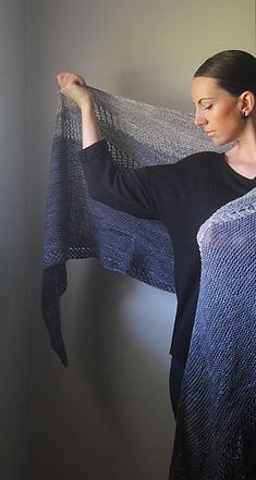 Angled short row sections and mesh-like lace make this oversized, semi circular shawl dramatic and luxurious.