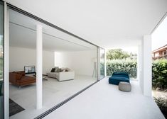 Square holes puncture five sides of Casa H by Bojaus Arquitectura