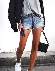Street style, casual chic, black jacket, gray tee, denim shorts, white sneakers