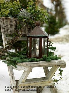 Rustic wood chair, winter greenery, basket and lantern. Love the simplicity of this look
