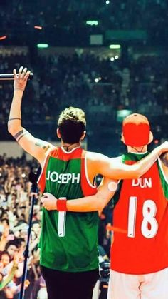 Aw. Matching jerseys << aw the numbers are their birthdays THEY'RE SO CUTE