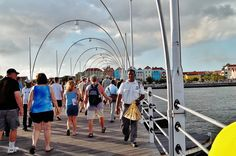 Walking across the Queen Emma Bridge