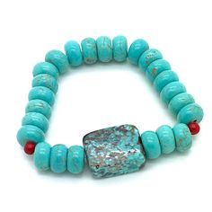 Southwest Feel is a Stretch Bracelet Made with Turquoise, Magnesite and Red Coral. Great for Making a Single Statement or for Stacking With Your Other Favorite Bracelets! Product 16-081