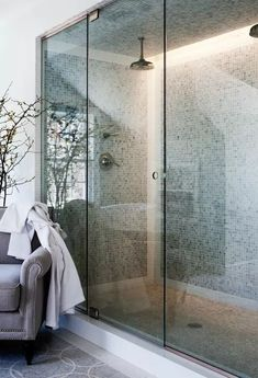 Fabulous bathroom with large shower for two featuring his and her rain shower heads and green mosaic tile shower surround and ceiling. Mosaic Shower Tile, Tile Walk In Shower, Big Shower, Large Shower, Shower Tub, Wet Room Bathroom, Modern Master Bathroom, Modern Bathroom Design, Small Bathroom