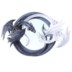 For the dragon lover, this mirror will add a touch of magic to the home! Two dragons curl together, noses nearly touching. One of the dragons is ebony, and the other white. Their long bodies and tails form the circular frame of the mirror. A unique addition to the decor!
