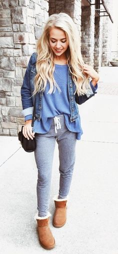 #fall #outfits women's blue chambray jacket, scoop-neck shirt, gray drawstring track pants, and pair of brown winter booties