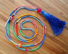 Hippie style, long beaded necklace with blue tassel.The necklace features czech glass seed beads, glass evil eye bead, glass beads and blue tassel. Beaded Tassel Necklace, Tassel Jewelry, Seed Bead Necklace, Beaded Bracelets, Seed Beads, African Necklace, African Jewelry, Colar Boho, Cool Necklaces