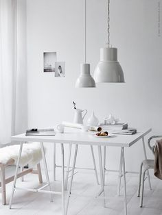 All white dining room | white lampshades, white table, wooden bench, sheepskin rug, white jug | @styleminimalism