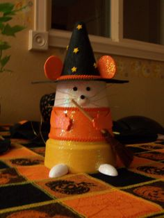 Saw something similar in a magazine and figured I could make it with a clay pot.  I think it turned out great. Halloween decorations.