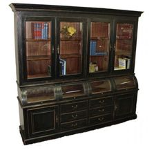 """Country Store Display Cabinet: Four beveled glass doors grace the top of this unit, while an amazing row of curved glass, curio styled """"drawers"""" give this great display cabinet a presence from days gone by. Made of mahogany with an antique black finish the cabinet also has six drawers and two raised panel doors! You can picture this in a old country store stocked with goods in old tins and small boxes of penny candy."""